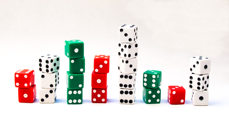 Several Stacks of Red, Green, and White Dice Cubes on a white background