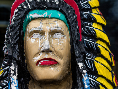 Closeup of a Colorful Carved Wooden Indian Statue Stock Photo