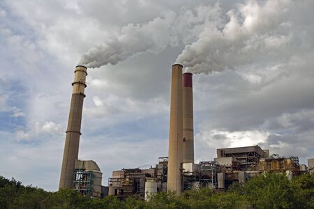 Coal-fired Power Plant with three smokestakes spewing steam Reklamní fotografie