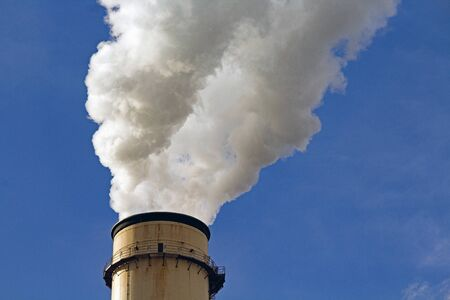 Closeup of a Single Smokestack at a Coal-fired Power Plant spewing Steam Reklamní fotografie