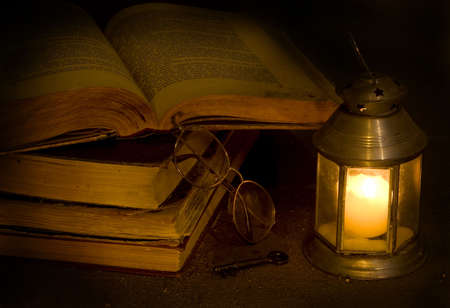Open antique books the darkness of night photo