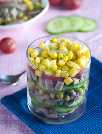 A beef tongue salad with cucumber and maize photo