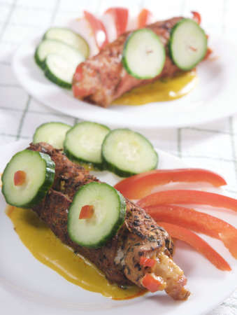 Beef rolls and vegetables photo