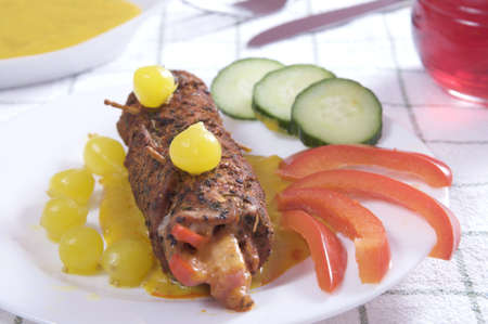 Beef rolls with cucumbers and tomatoes photo