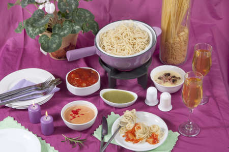 pasta  fondue with different sauces photo