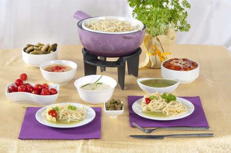 molhos: pasta  fondue with different sauces Banco de Imagens