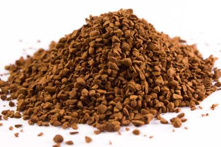 pile of coffee granules on a white background