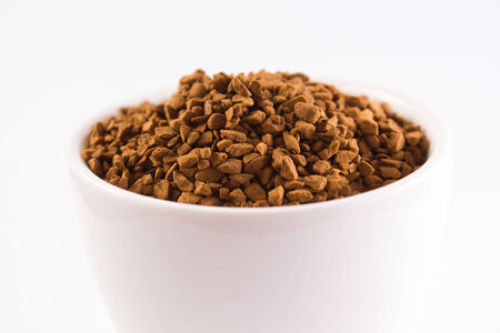 white cup full of coffee granules  photo