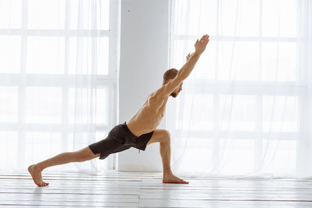 Man practicing advanced yoga. A series of yoga poses. Lifestyle concept