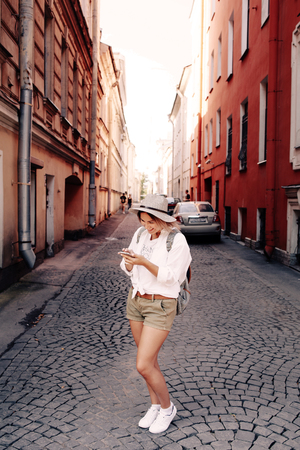 Tourist using navigation app on the mobile phone. Travel concept. Adventure