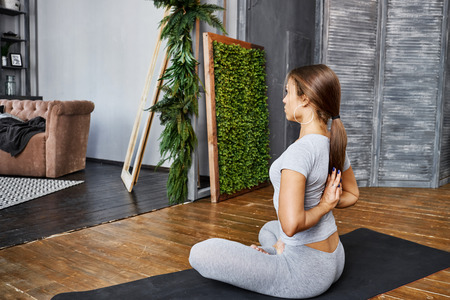 Woman Practicing Advanced Yoga In The Living Room At Home. A.. Stock ...