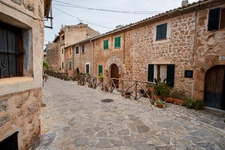 Old European street decorated with fresh flowers city of Valldemossa. Palma de Mallorca. Spain.