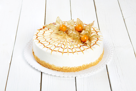Mousseous cake on a white wooden table