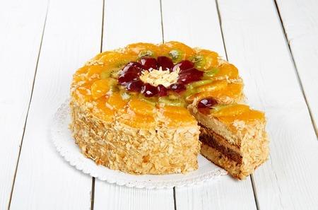 Orange cake on a white wooden table