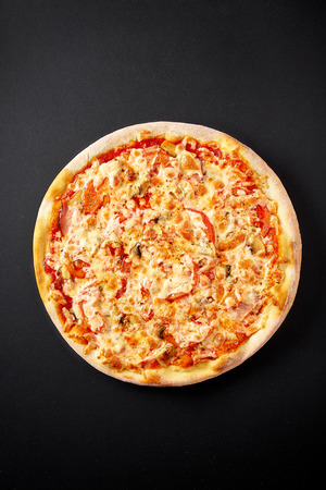 Bolognese pizza. Hot pizza on black background for lunch or dinner crust. Pizza menu.