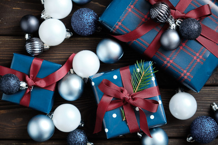 Christmas decorations and Christmas gifts on an old wooden table. Christmas background. New year 2019