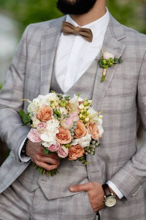 Man Clothed Stylish Suit Holding Bouquet of Flower. Bearded Character Caucasian Young Male Wearing Elegant Bow Tie, White Shirt and Fashion Jacket Decorated Boutonniere.