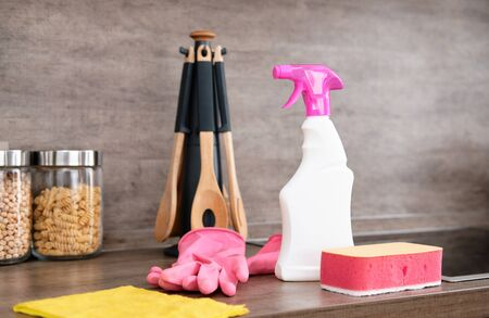 Detergents and cleaning accessories on kitchen. Cleaning and Washing Kitchen. Cleaning service concept