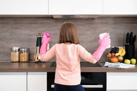 Preschool Girl doing Cleaning Kitchen. House cleaning