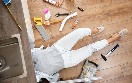 Woman fixing kitchen sink Stock Photo