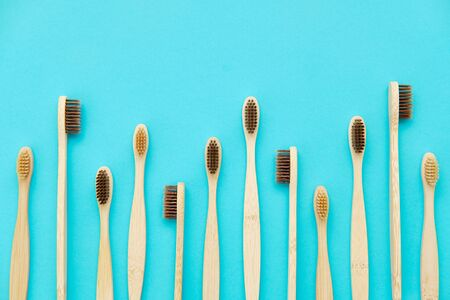 Wooden Toothbrush Isolated on Blue Background Copy Space Flat Lay. Tooth Brushes Scattered on Table. Collection of Elegant Ecological Clear Healthcare Bath Accessory for Clean Teeth