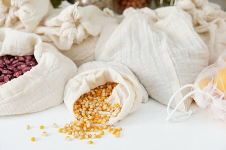 Vermicelli Macaroni Peas Beans Chickpea Lentils Agricultural Cereal Types in Textile Fabric Bag Set Isolated on White Background Flat Lay. Collection of Healthy Vegetarian Food in Pouch