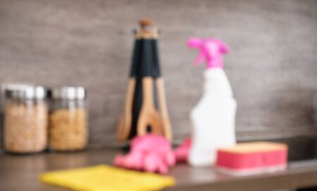 Blur Picture. Detergents and cleaning accessories on kitchen. Cleaning and Washing Kitchen. Cleaning service concept.