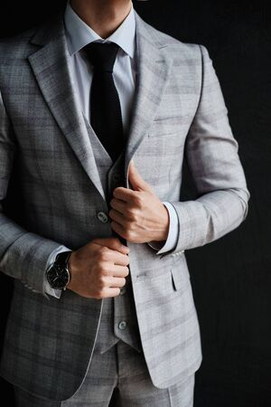Standing Character Confident Businessman in Suit. Slim Young Man in Corporate Style Wearing Light Checked Jacket and Pants, White Shirt and Tie Isolated on Black Background. Studio Photo Stok Fotoğraf