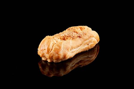 Traditional Classical French Eclair Profiteroles Isolated on Black Background. Sweet Healthy Homemade Vegetarian Cream Pastry. Delicious Bakery Biscuit Cake Dessert. Confectionery Breakfast