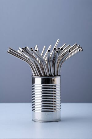 Reusable Steel Drinking Straw in Metallic Color in Metal Cup. Aluminum Stainless Bar Equipment for Drink Alcohol Cocktails, Juice or Lemonade. Chrome Tubing