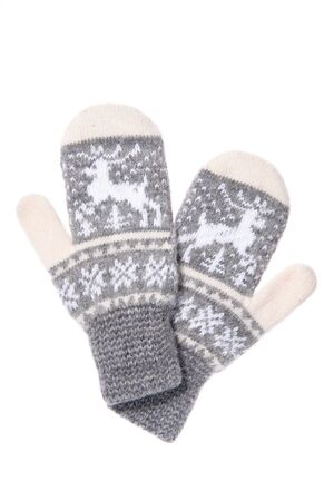Warm woolen knitted mittens isolated on white background. Gray k