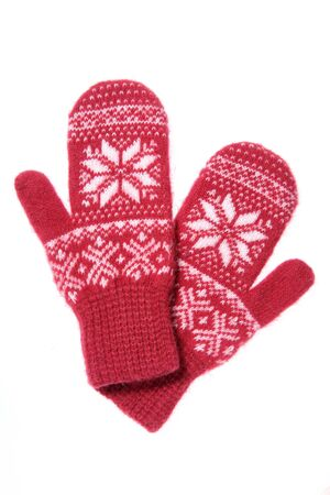 Warm woolen knitted mittens isolated on white background. Red kn 免版税图像