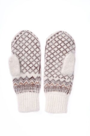 Warm woolen knitted mittens isolated on white background 免版税图像