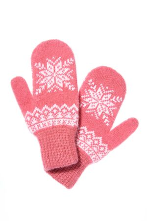 Warm woolen knitted mittens isolated on white background. Pink k