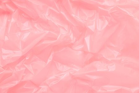 Close up Texture of a Pink Plastic garbage Bag. Pink polyethylen