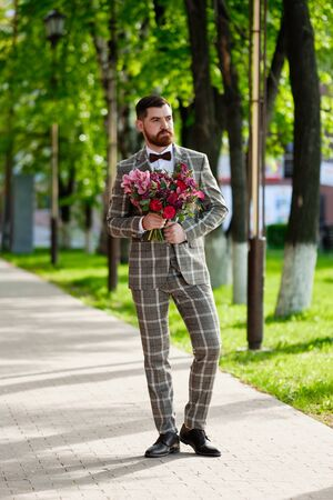 Man Clothed Stylish Suit Holding Bouquet of Flower