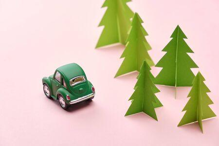 Retro car on trendy colored paper. Paper cut.