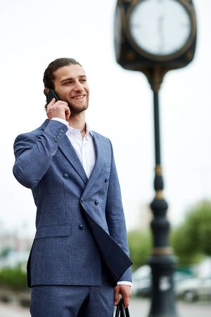 Attractive bearded young man in classic suit with bag. Elegancy