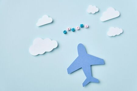 Handicraft from colorful paper Airplane and clouds 免版税图像