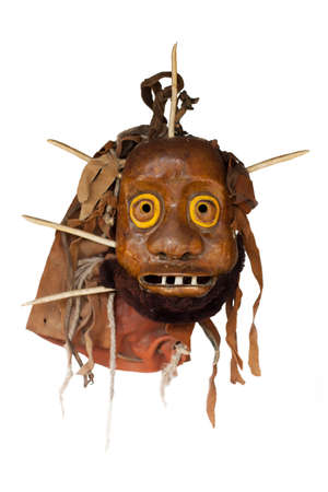 LIthuanian folk art - traditional wooden masks of devils, horses, warriors, shamans, witches, spirits and animals like wollf and goat. Used as a souvenir or in carnival festivals. Handmade mainly of wood and natural materials. Stock Photo
