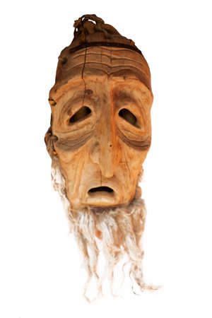 LIthuanian folk art - traditional wooden masks of devils, horses, warriors, shamans, witches, spirits and animals like wollf and goat. Used as a souvenir or in carnival festivals. Handmade mainly of wood and natural materials. Фото со стока