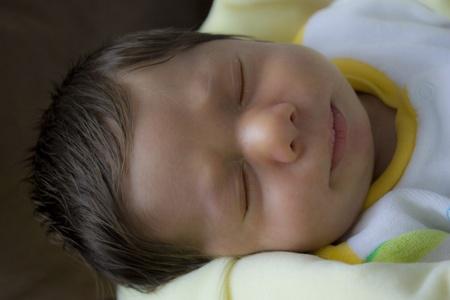 nursling: newborn sleeping baby  Stock Photo