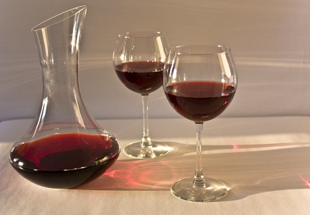 carafe: a carafe of red wine and two glasses