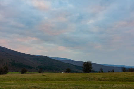 landowners: Grass, mountains and sky Stock Photo
