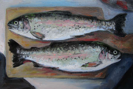 Two fishes. Trout on a wooden board.