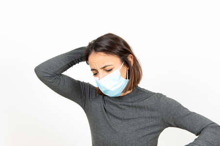 Dispaired latin woman wearing a medical face mask. Mental health during pandemic concept.