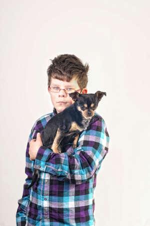Boy holding a chihuahua photo