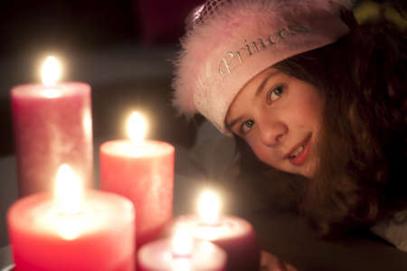 Christmas girl with candles photo