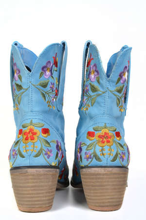 leather blue flower boots rear view against white background photo
