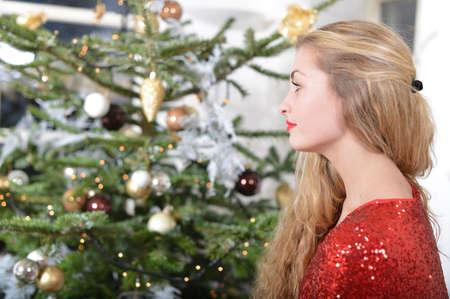 girl standing beside the christmas-tree